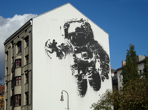 back to bionic astronaut graffiti by bansky wall berlin germany street art bansky subway An astronaut floating above the subway