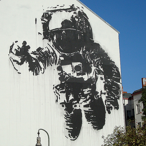 back to bionic astronaut graffiti by bansky wall berlin germany street art bansky zoom An astronaut floating above the subway